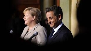 Nicolas Sarkozy and Angela Merkel speak during a joint press conference  on the sidelines of a tripartite summit France, Germany and Russia in Deauville
