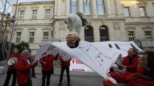 Front de Gauche activists with a Nicolas Sarkozy puppet