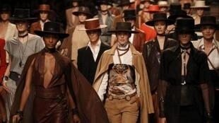 Models present creations by French designer Jean-Paul Gaultier women's ready-to-wear collection for French fashion house Hermes