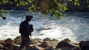 A US Army soldier conducts a  patrol in the province of Nuristan where the IAM team were on a aid mission before being attack by gunmen