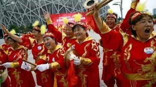 Performers celebrate the award to Beijing of the 2022 Winter Olympics in front of the Bird's Nest Stadium which will stage the opening ceremony.