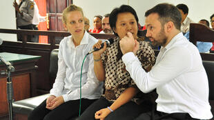 The two French journalists, Valentine Bourrat and Thomas Dandois,with an interpreter in Jayapura