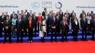 Leaders pose for a family photo during U.N. climate change conference (COP25) in Madrid, Spain, December 2, 2019.