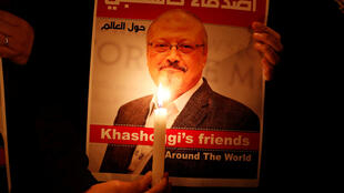 A poster with a picture of Saudi journalist Jamal Khashoggi outside the Saudi consulate in Istanbul, Turkey, 25 October 2018.