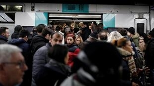 Commuters board a regional train at Chatelet-les Halles station during a pensions strike by transport unions.