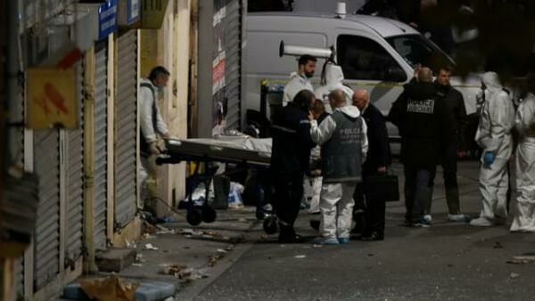 One of the bodies is taken out of the Saint-Denis flat after the police raid