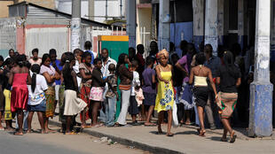 Residents queue for bread in streets of Mozambique's capital, Maputo