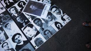 Fotos de personas asesinadas o desaparecidas durante el franquismo, durante una manifestación en Madrid este 26 de septiembre.