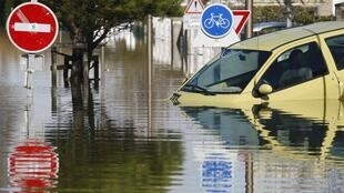 A vehicle submerged in flood water on the streets of Aytre, in south-west France.