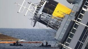 Rescue workers around the stricken vessel on Thursday