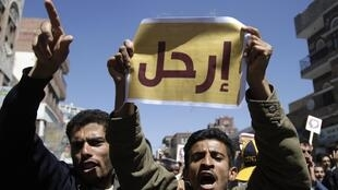 Anti-government protesters shout slogans during a demonstration in Sanaa on February 15, 2011.