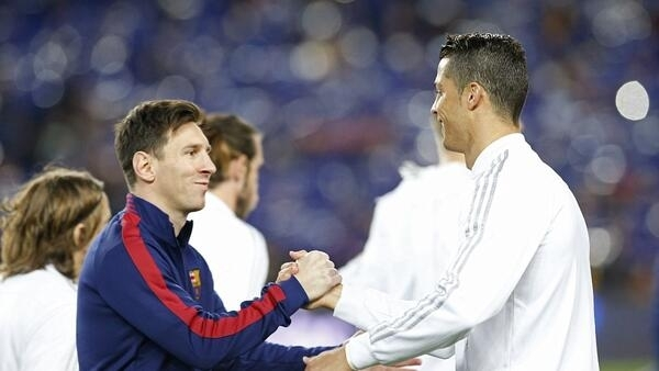 Star players Lionel Messi and Cristiano Ronaldo greet each other at a Barcelona-Madrid match