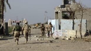Forças de segurança iraquianas, em Ramadi, oeste de Bagdá.