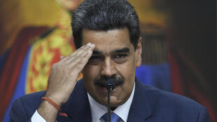 (FILES) In this file photo taken on February 14, 2020 Venezuela's President Nicolas Maduro gestures during a press conference