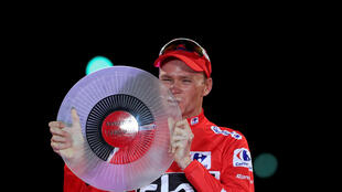 Chris Froome shows off the Vuelta trophy which he won in September to become only the third man to win in Spain and France in the same year.