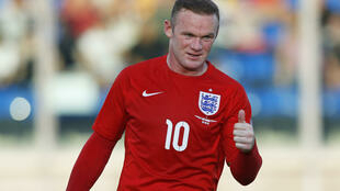 Wayne Rooney scored a record 50th international goal during England's 2-0 win over Switzerland.