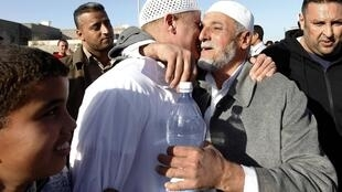 A member of the Libyan Islamic Fighting Group hugs a relative upon his release from Abu Salim prison near Tripoli