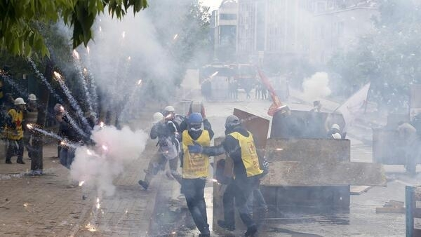 Tear gas is fired at protesters on Istanbul's Taksim Square, next to Gezi Park