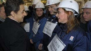France's President Nicolas Sarkozy speaks with workers at Fessenheim nuclear plant