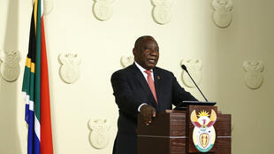 South African President Cyril Ramaphosa addresses the nation on the COVID-19 epidemic in Pretoria on March 15, 2020; Ramaphosa said the country would close its borders to all foreign nationals from countries highly impacted by the virus