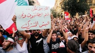An anti-government protest in downtown Beirut, Lebanon October 20, 2019. The banner reads ''You are the sectarians and we are the co-existentialists''.