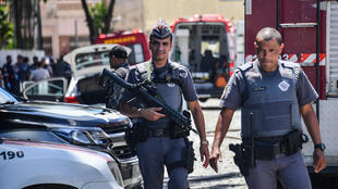 Police at the scene of the school shooting in Suzano, Sao Paulo metropolitan region, Brazil, 13 March 2019.