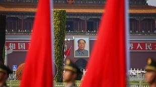Soldiers from the honour guards of the Chinese People's Liberation Army (PLA) line up against a backdrop of a portrait of late chairman Mao Zedong hanging on the Tiananmen Gate, during a welcoming ceremony for Kuwait's Prime Minister Sheikh Jaber al-Mubara