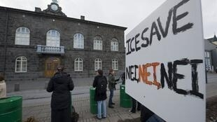 Demonstrators outside Iceland's parliament in February