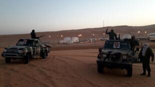 FILE PHOTO: Members of forces loyal to Libyan military commander Khalifa Haftar guard near Libya's El Sharara oilfield in Obari,Libya, February 6, 2019.