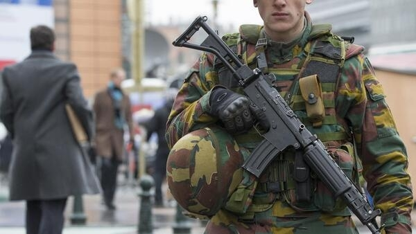 A Belgian soldier guards an entrance of the European Council headquarters in central Brussels