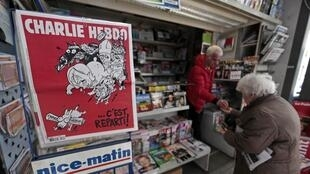 Charlie Hebdo journalists are brushing off controversy surrounding a literary association's decision to award the magazine a top prize for freedom