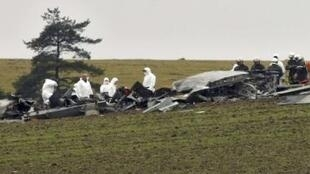 French rescuers and forensic experts inspect the plane's wreckage