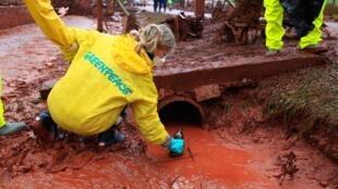 Greenpeace activist take samples