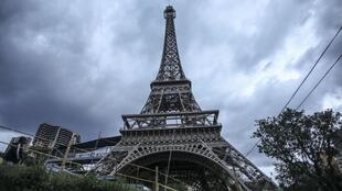 The Eiffel Tower was evacuated Monday afternoon after someone scaled the face of it.