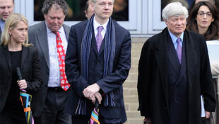 WikiLeaks founder Julian Assange leaves after his extradition hearing at Belmarsh Magistrates' Court in London