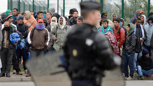 Illegal immigrants about to be evicted from their camp in Calais (France) on 28 May 2014.