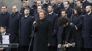 Johnny Hallyday performs with the French army choir during a remembrance rally at Place de la Republique, 10 January 2016