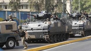 A Lebanese army convoy secures an area from clashes between the army and Sunni Muslim gunmen in Beirut
