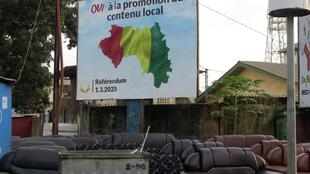 A referendum campaign poster supporting the reform of the constitution is pictured in Conakry, Guinea, February 27, 2020.