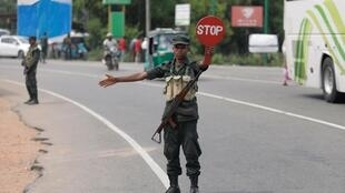 An army personnel member controls the traffic at a check point in Kattankudy near Batticaloa