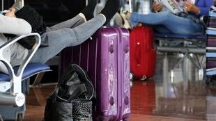 Passengers wait for their flight at Nice International airport on Tuesday
