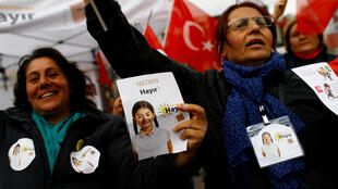 """Hayir"", ""No"" in English, supporters hold Turkish flags and leaflets for the upcoming referendum at a campaign point in Istanbul on 31 March, 2017."