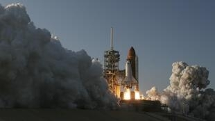 Space shuttle Discovery lifts off from the Kennedy Space Center in Cape Canaveral