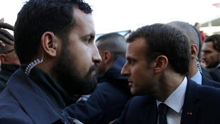 Alexandre Benalla (L) stands next to French President Emmanuel Macron during a visit to the Paris International Agricultural Show, 24 February 2018