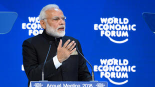 Indian Prime Minister Narendra Modi gestures as he delivers a speech at the opening day the World Economic Forum (WEF) 2018 annual meeting, on January 23, 2018 in Davos, eastern Switzerland. Fabrice COFFRINI / AFP