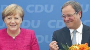 Angela Merkel et Armin Laschet (à dr.). «Notre pays a besoin de plus de cohésion et surtout de plus de confiance en soi», a indiqué ce garant de la continuité avec la politique de la chancelière.