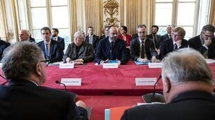 French Prime Minister Edouard Philippe (C) holds a crisis meeting with members of government, heads of parliament and senate and leaders of opposition parties, to address the outbreak of COVID-19 at Matignon, in Paris, on February 27, 2020