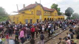 Thousands wait at Gevgelija station for trains to cross Macedonia.