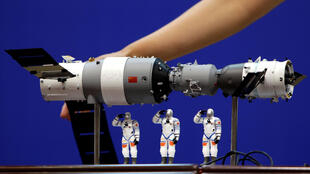 A file photo shows a model of the Tiangong-1 space lab module displayed during a news conference in June 2012.
