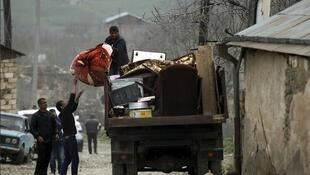 Residents of the village of Talish in Nagorno-Karabakh flee their homes on 6 April, 2016